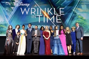LOS ANGELES, CA - FEBRUARY 26: (L-R) Actors Rowan Blanchard, Levi Miller, Deric McCabe, Gugu Mbatha-Raw, Chris Pine, Zach Galifianakis, Mindy Kaling, Reese Witherspoon, Oprah Winfrey, Storm Reid, Director Ava DuVernay, Screenwriter Jennifer Lee, Producers Catherine Hand and Jim Whitaker onstage at the world premiere of Disney's 'A Wrinkle in Time' at the El Capitan Theatre in Hollywood CA, March 26, 2018. (Photo by Alberto E. Rodriguez/Getty Images for Disney)