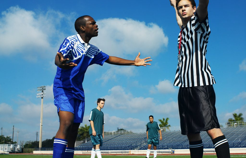 Soccer Referee Showing a Player the Red Card